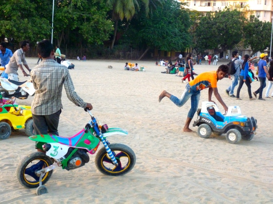 """The """"rides""""... guys pushing kids around on toys"""